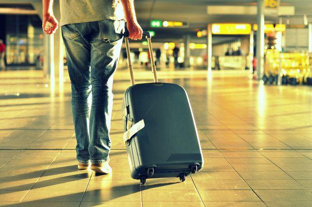 Man-with-suitcase-walking